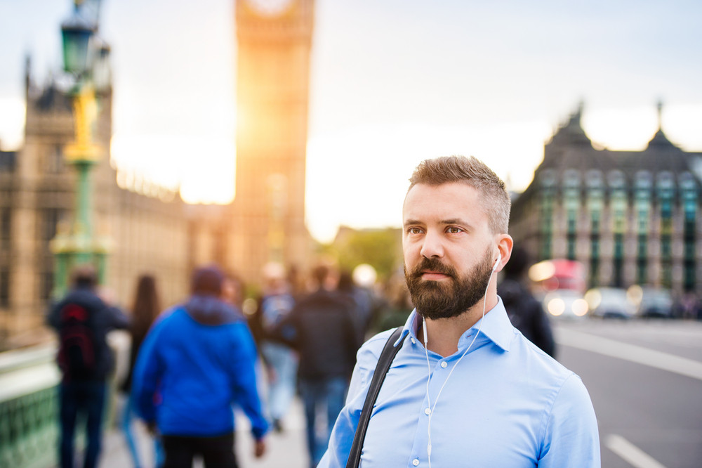 Handsome young man in blue shirt on Westminster bridge