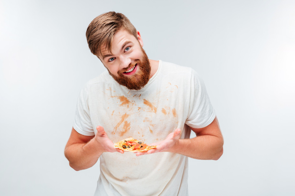 Happy bearded man holding slice of pizza on his palms isolated on white background