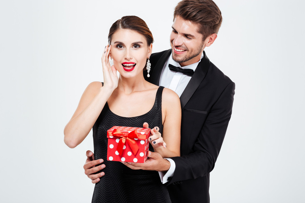 Happy business couple with gift. woman so happy. isolated white background