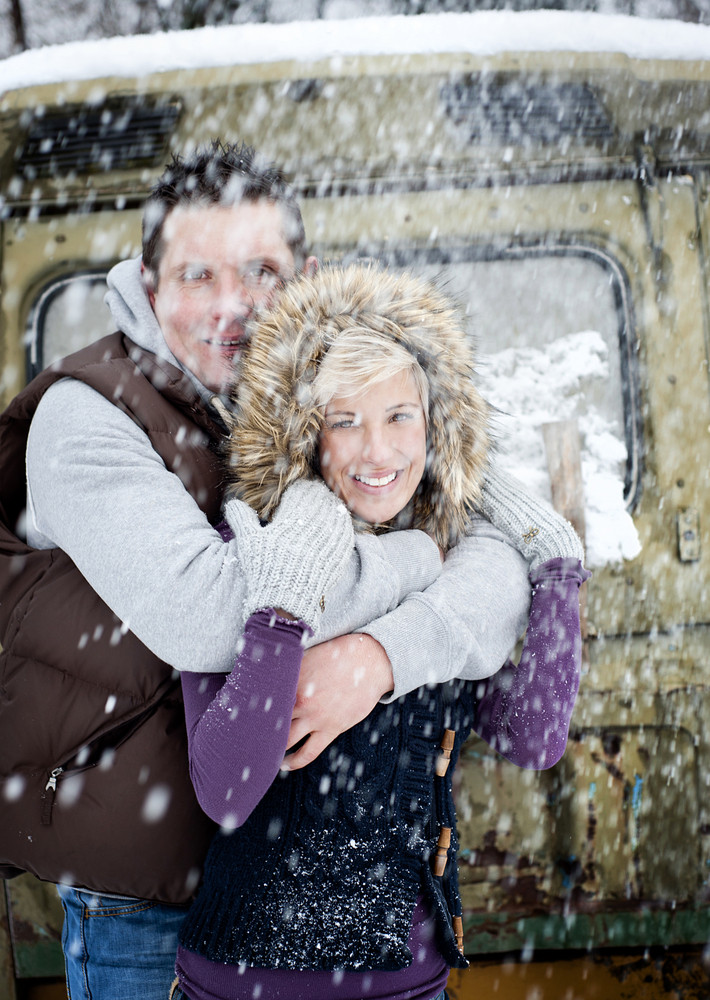 Happy couple is relaxing in snowy countryside