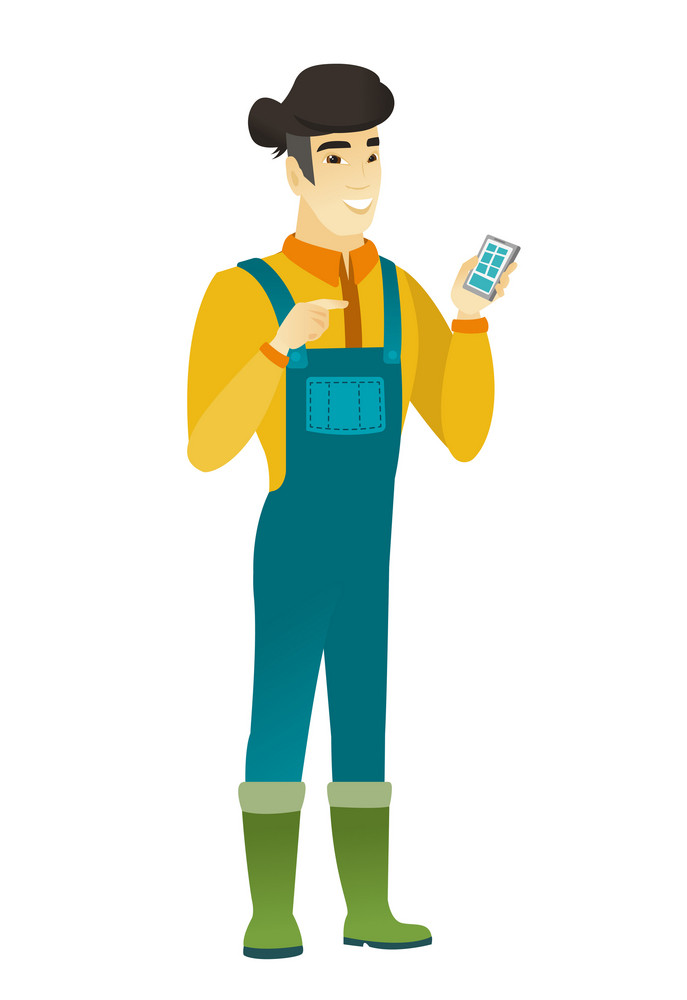 Happy farmer in coveralls holding mobile phone and pointing at it. Full length of farmer with mobile phone. Farmer using mobile phone. Vector flat design illustration isolated on white background.