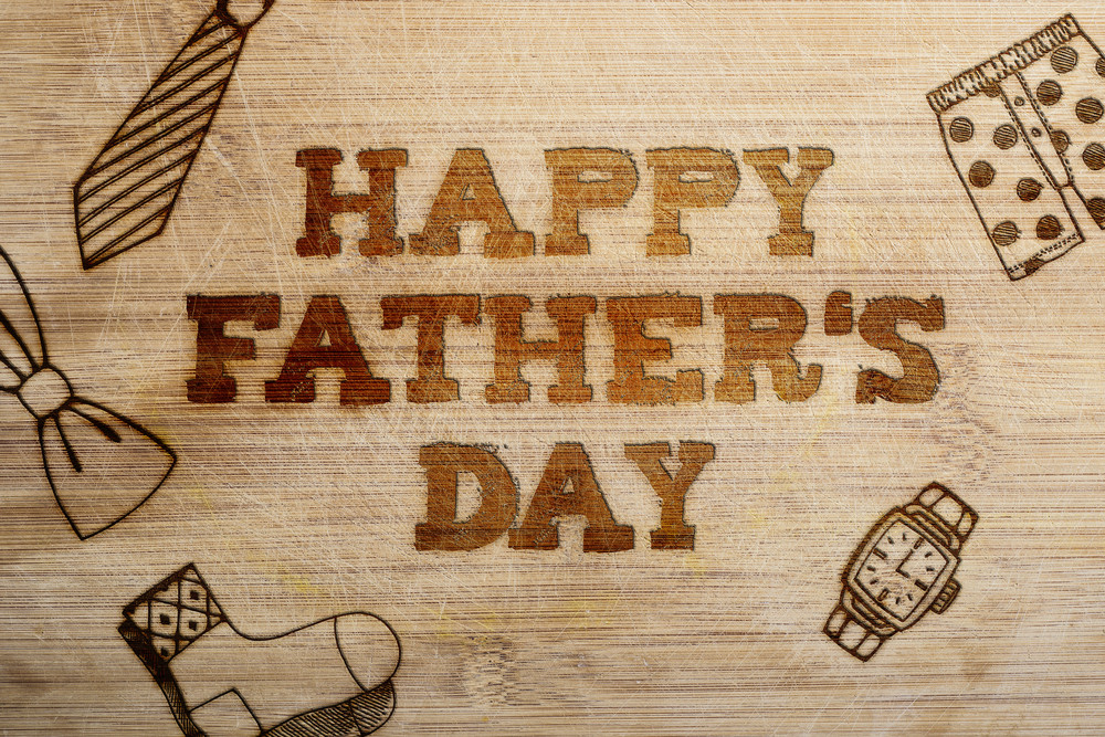 Happy fathers day sign on wooden boards background.