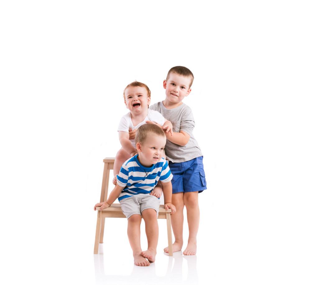 Happy little boys. Studio shot on white background.