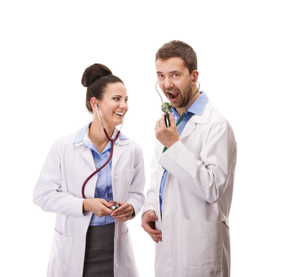 Happy medical team of doctors, man and woman, isolated over white background