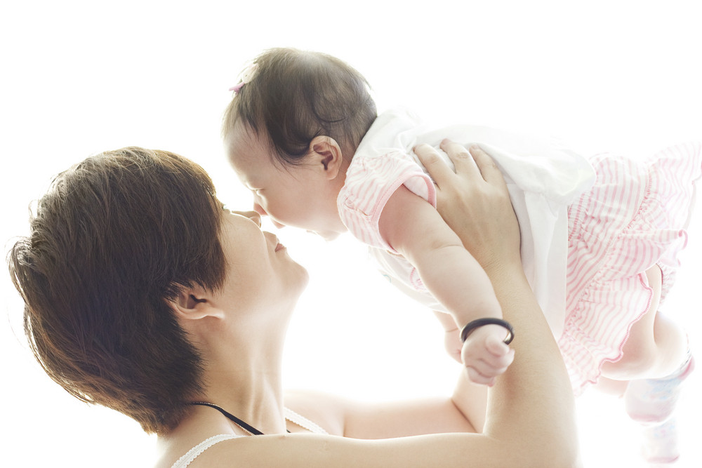 Happy mother and smile baby