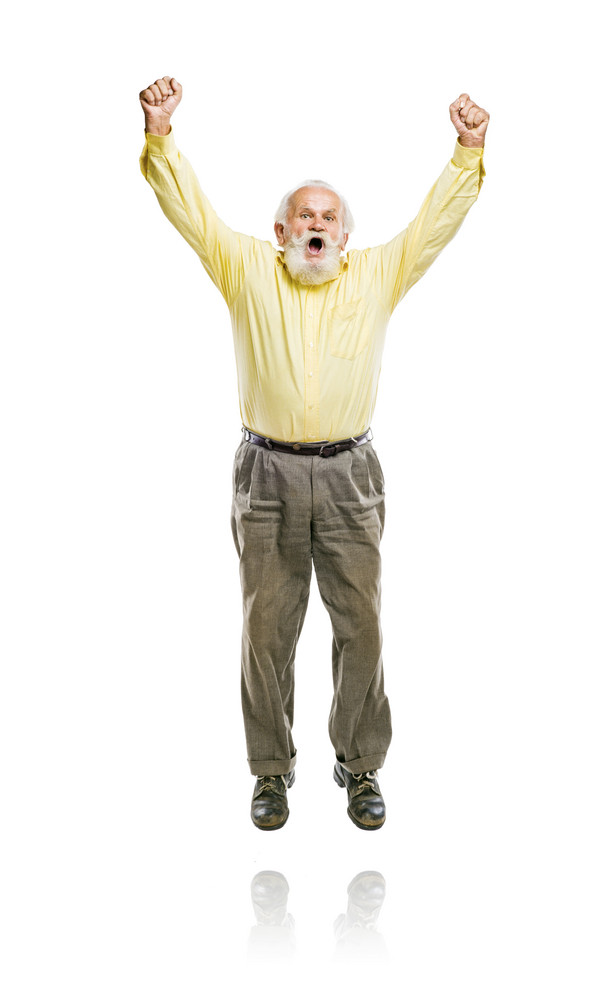Happy old active bearded man jumping isolated on white background