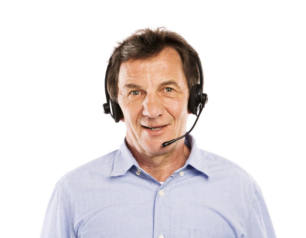 Happy senior man wearing headset, isolated on white background