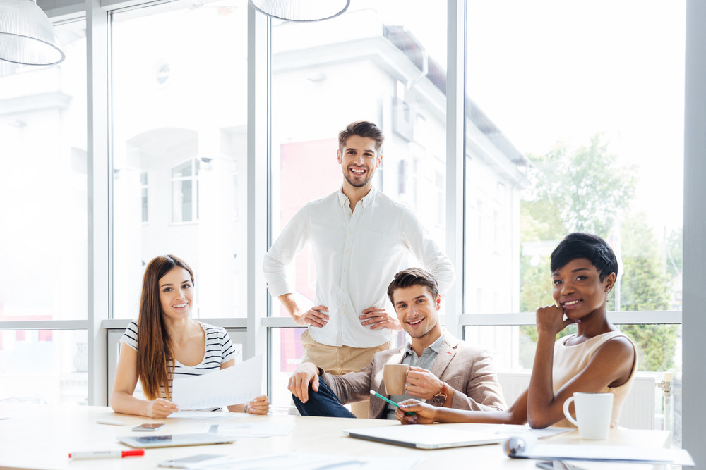 Happy successful multiethnic group of business people in office