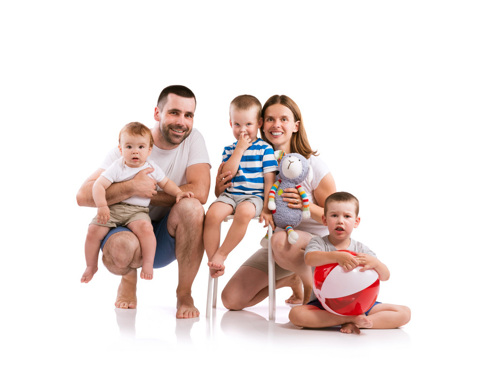 Happy young  family. Studio shot on white background.