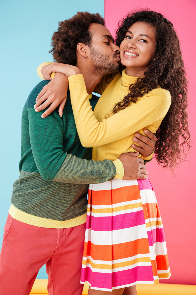 Hapy african young couple in love kissing and hugging