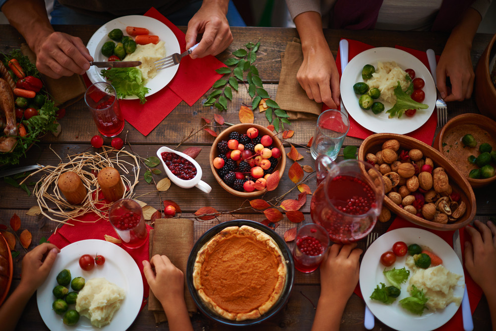 High angle view of festive table and people eating