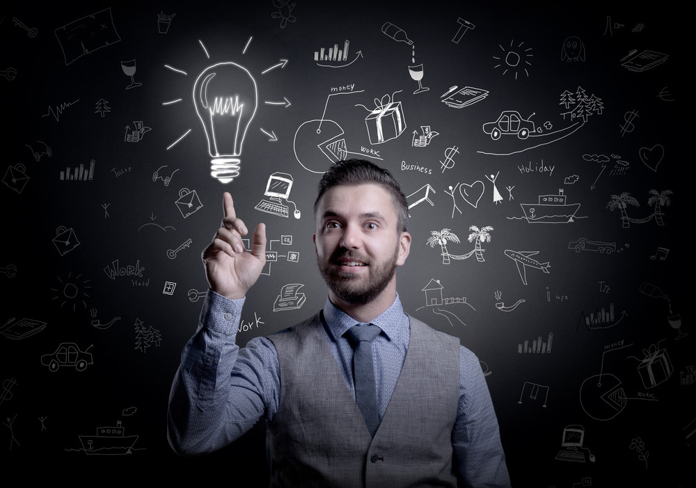 Hipster businessman with idea, light bulb above his head, isolated on black background