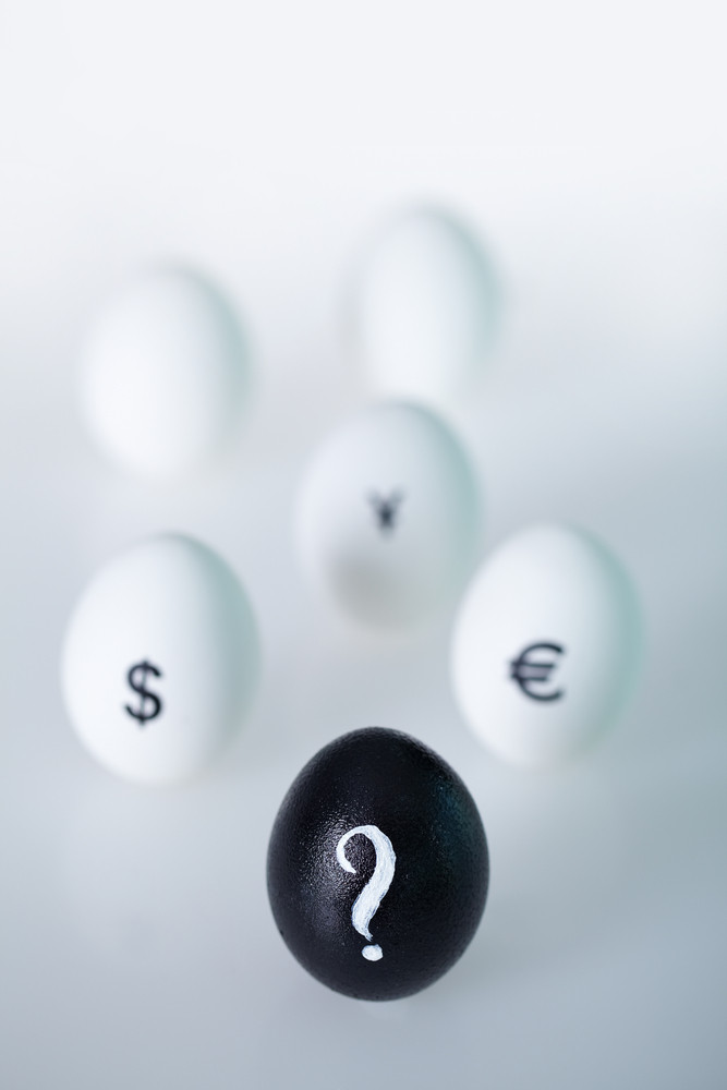 Image of black egg with question mark with group of eggs on background