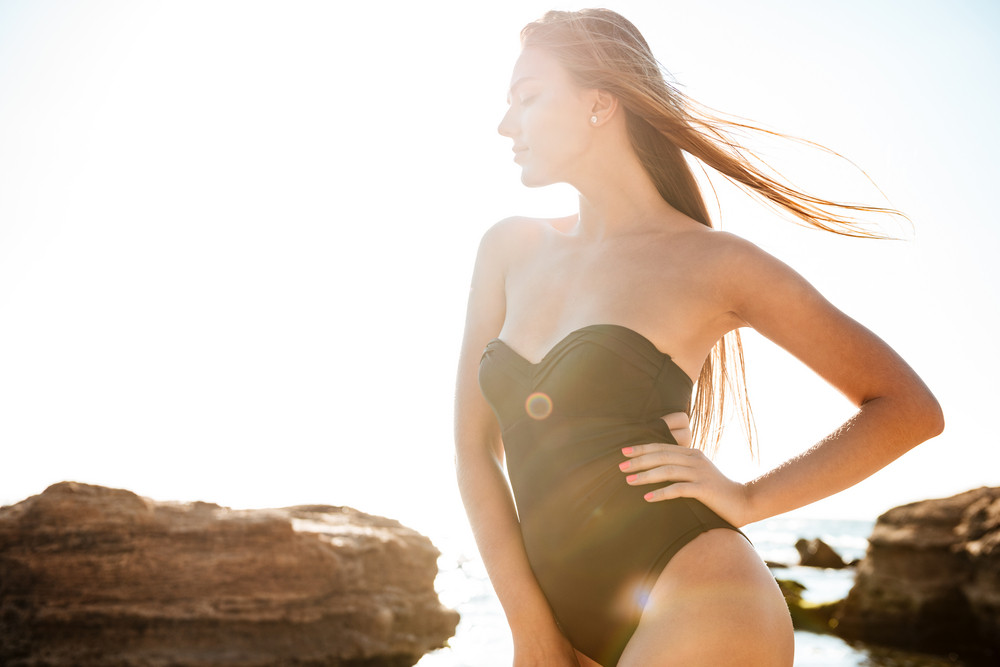 Image of girl in swimsuit. so cool photo. near the rocks