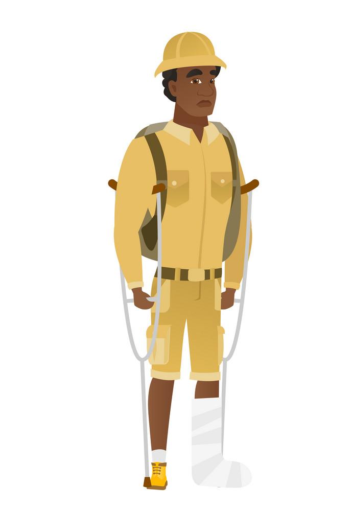 Injured african-american traveler with broken leg on crutches. Traveler with broken leg in bandages. Full length of man with broken leg. Vector flat design illustration isolated on white background.