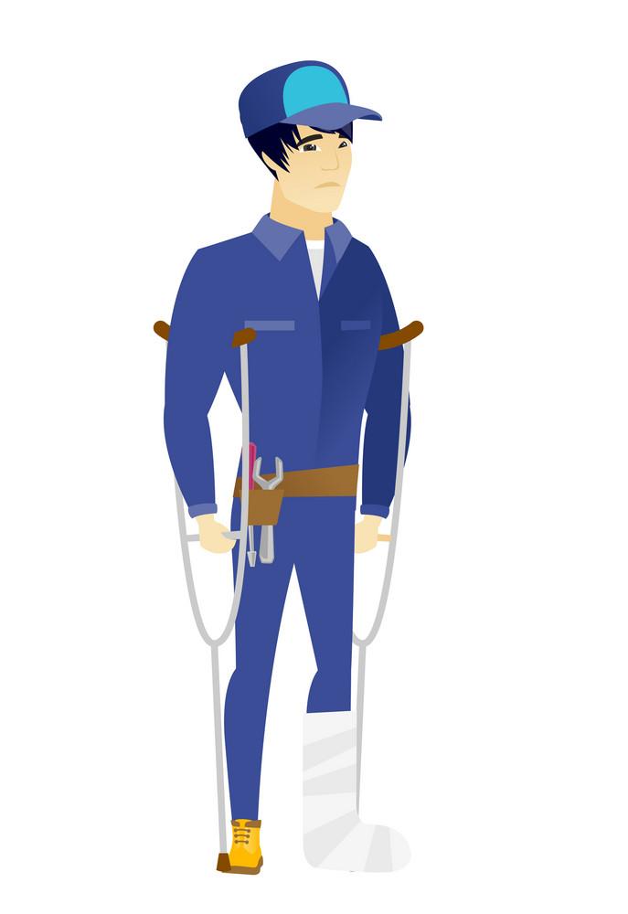 Injured asian mechanic with broken leg on crutches. Mechanic with broken leg in bandages. Full length of young mechanic with broken leg. Vector flat design illustration isolated on white background.
