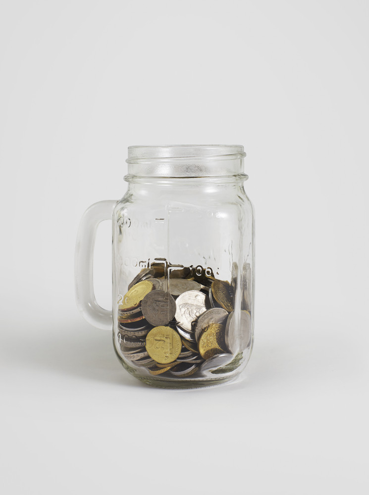 Jar with coins, money isolated on white with clippiing path