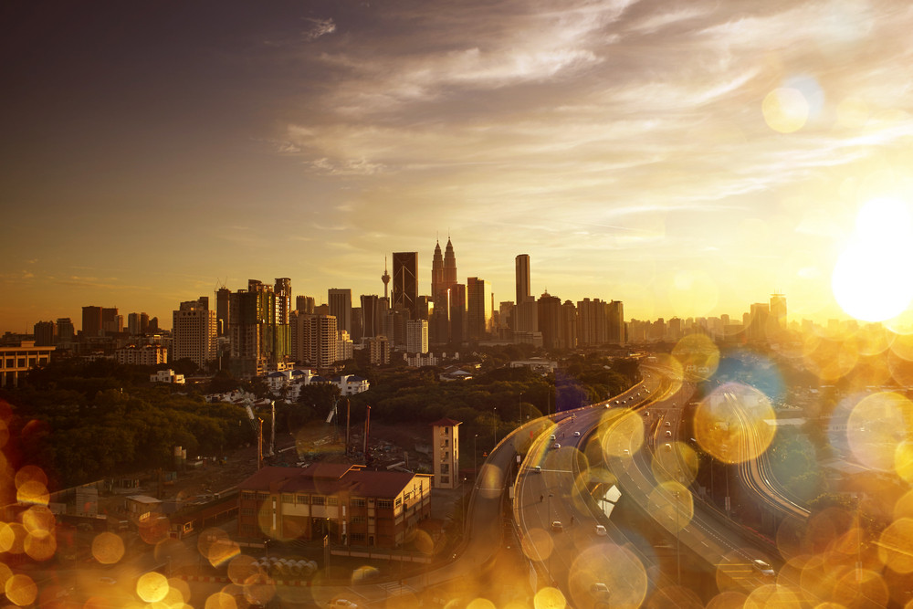 Kuala Lumpur Skyline. Abstract cityscape view  with effect blur, bokeh, light point, color flows. The world of light and color.