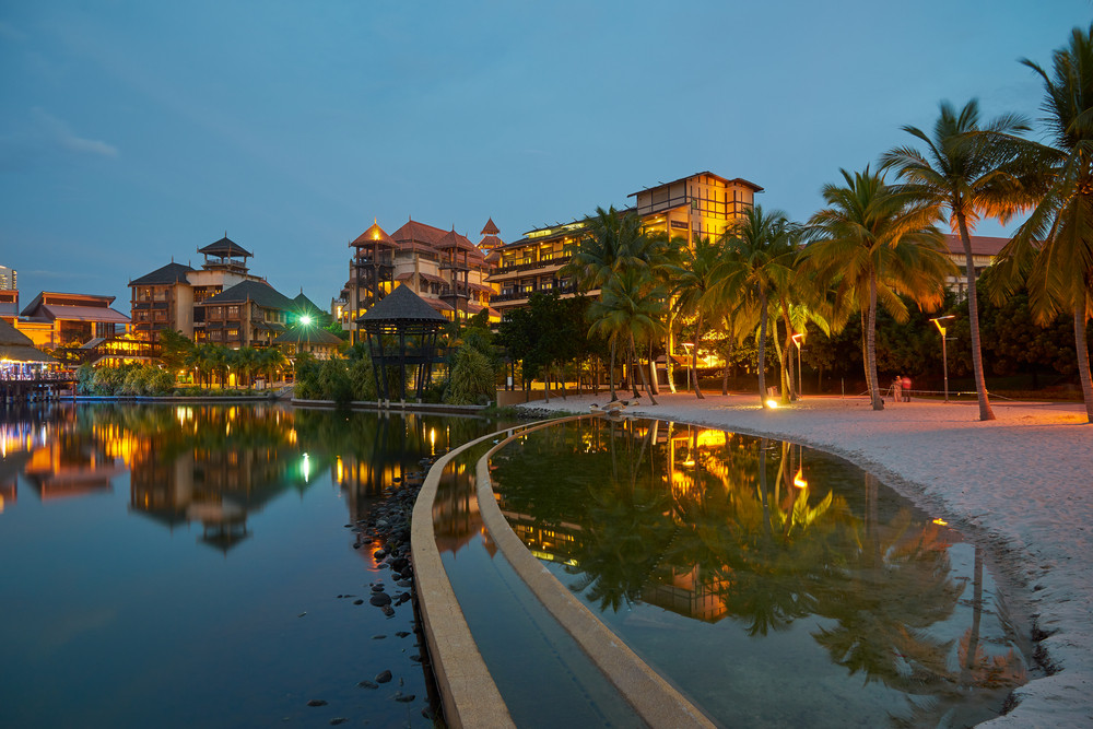 Landscape of modern buildings by the lakeside with jetty in Putrajaya, Malaysia during twilight