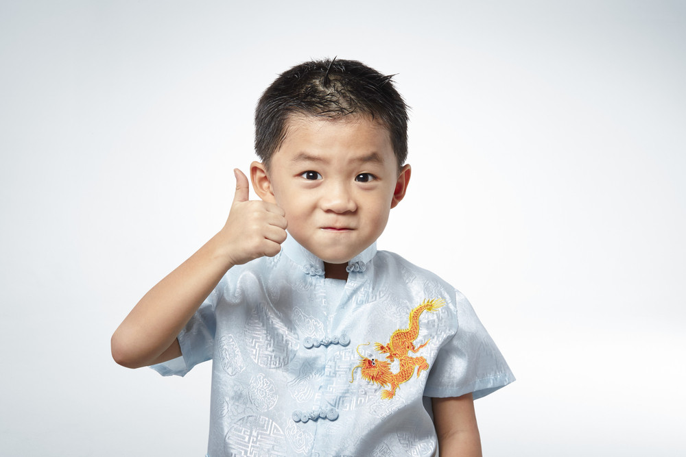 little boy giving you thumbs up