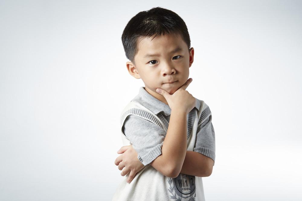 little boy smart pose