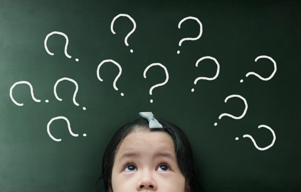 little girl thinking with question mark over her head
