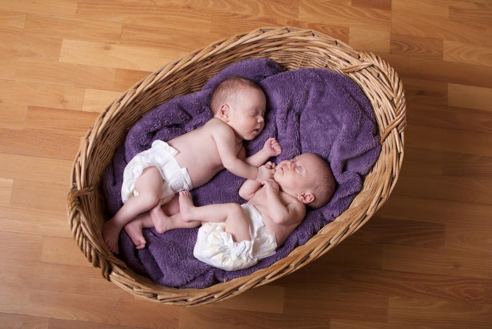 Little newborn twins are sleeping.