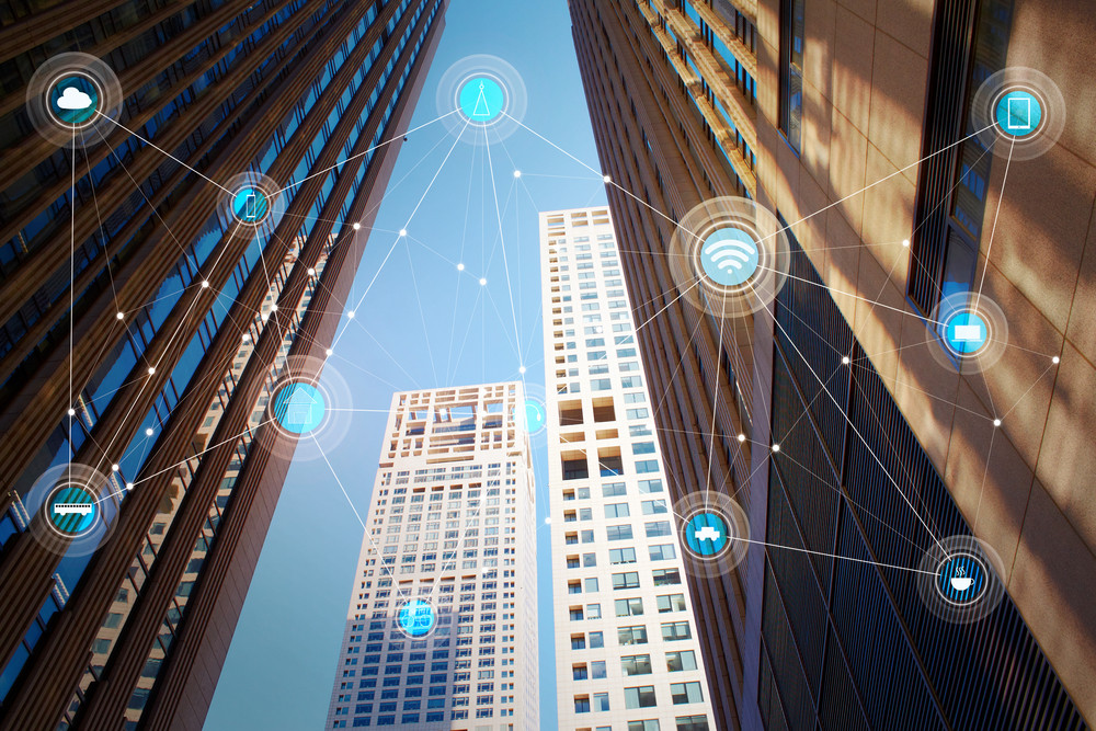 Looking up lower angle exterior commercial building and wireless communication network, abstract image visual, internet of things .