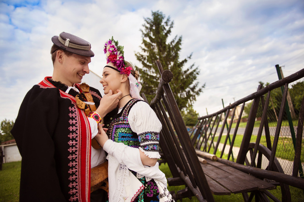 Love couple wearing traditional Eastern Europe folk costumes.