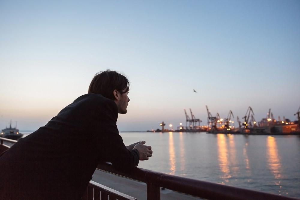 Man in port. looking away. near the sea. Odessa port