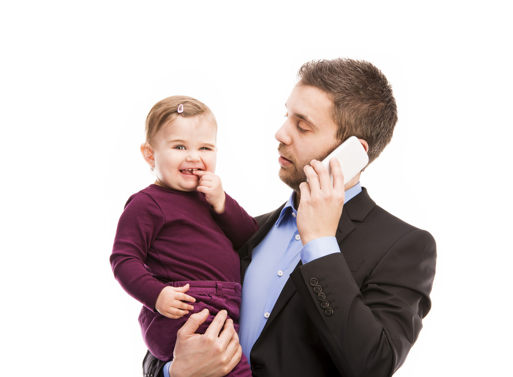 Man with his baby is working. Manager is using mobile phone.
