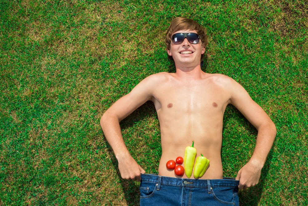 Man with vegetables is lying on the grass