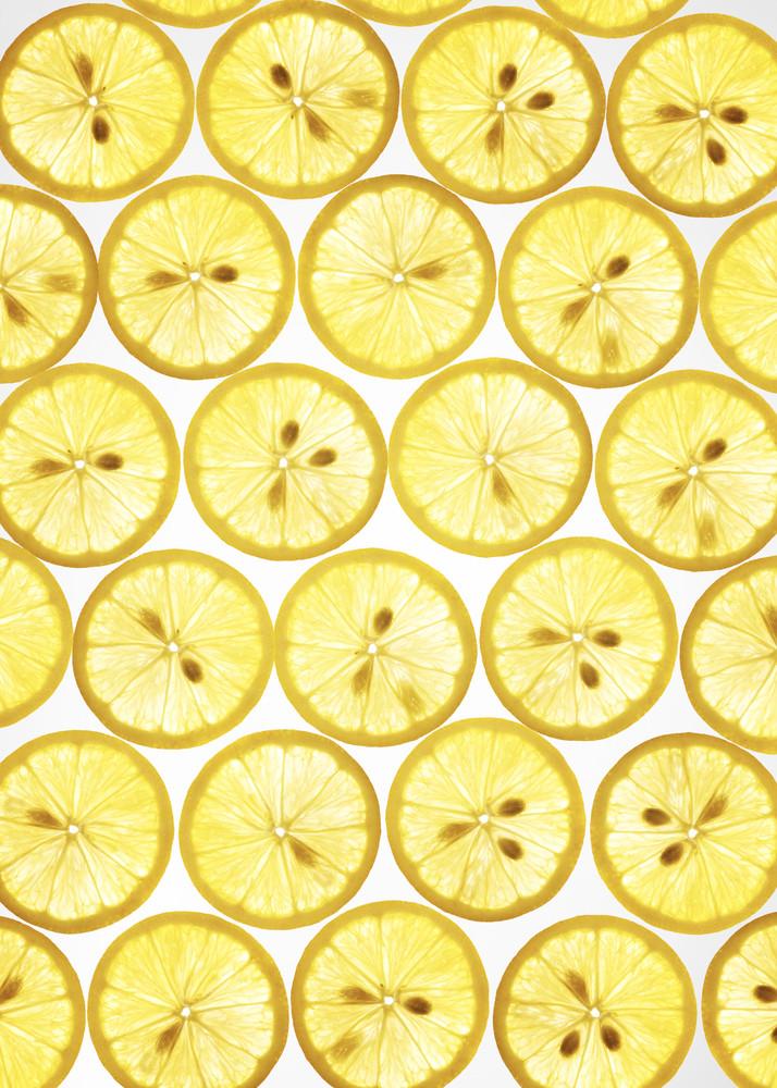 Many rings Lemon on white background , back lit .