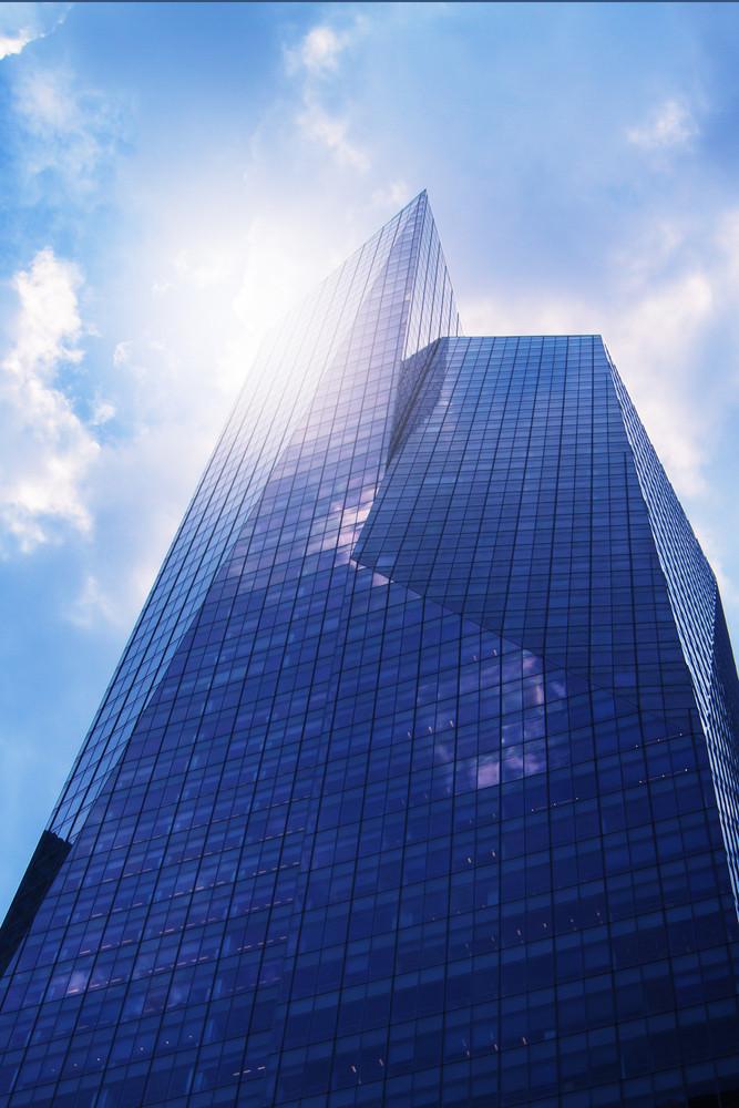 Modern office building (skyscraper) in sunlight.Toned image.