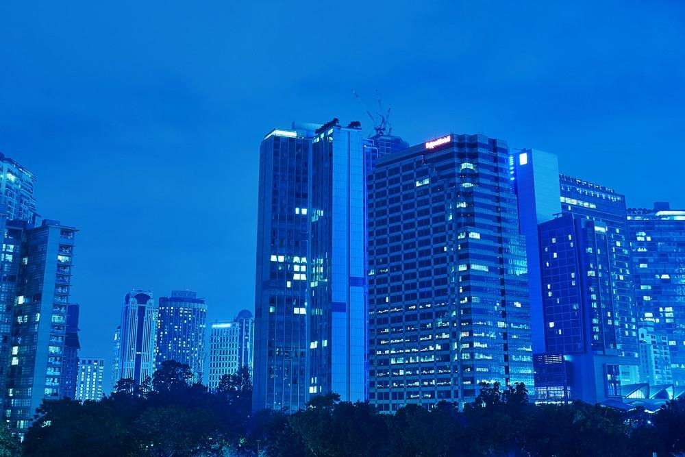 Modern office buildings at night in Kuala Lumpur