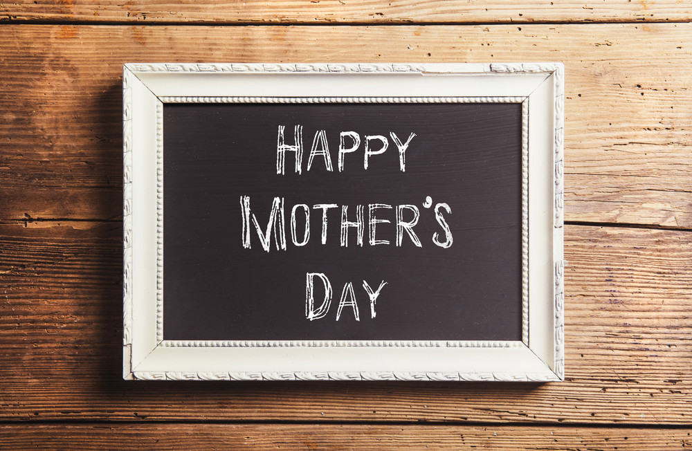 mothers day composition chalk sign in picture frame studio shot on