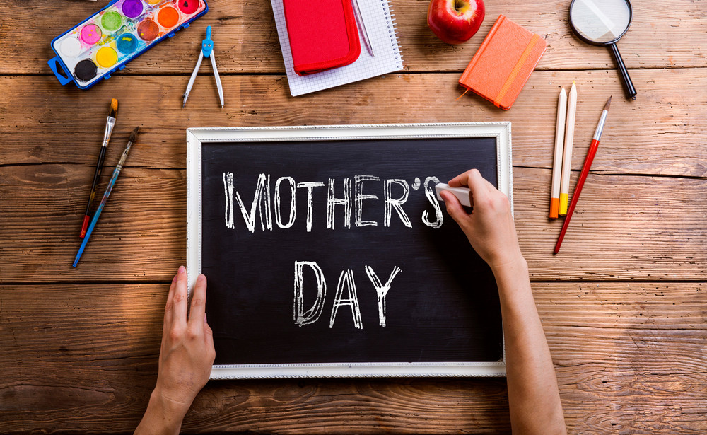 mothers day composition hands of unrecognizable man writing with