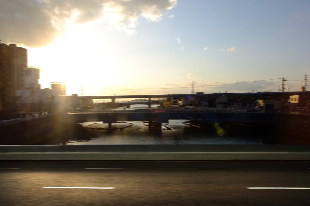 motion blurred asphalt road and street side view , evening scene .
