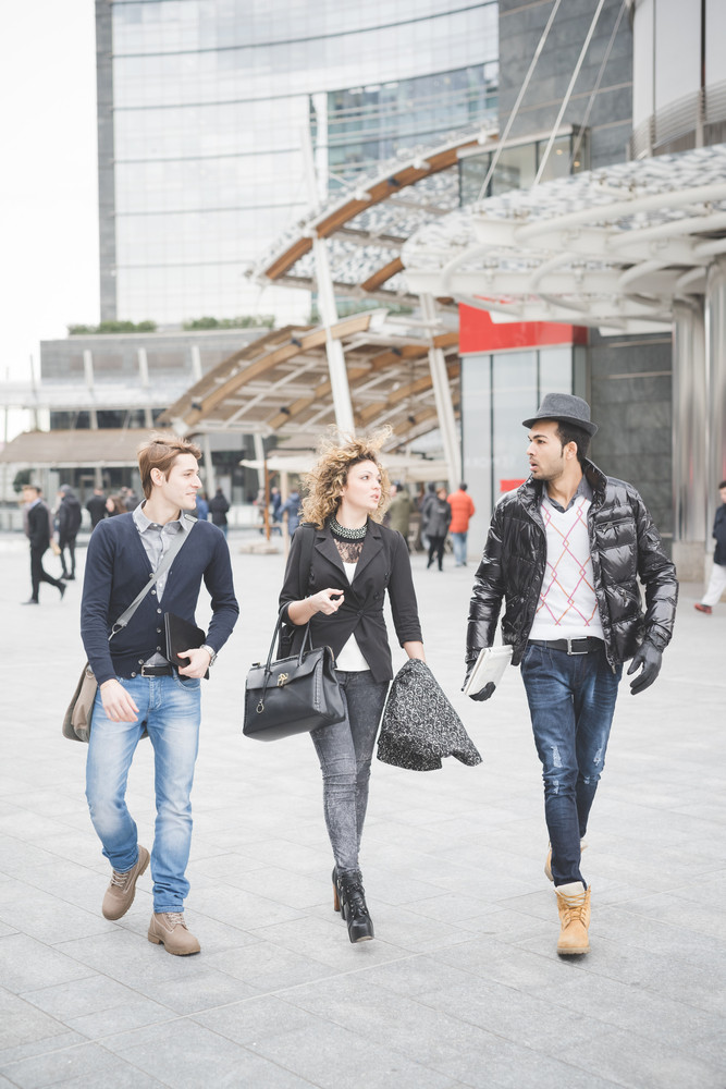 Multiracial contemporary business people walking outdoor in the city, working and talking together - finance, business, technology concept