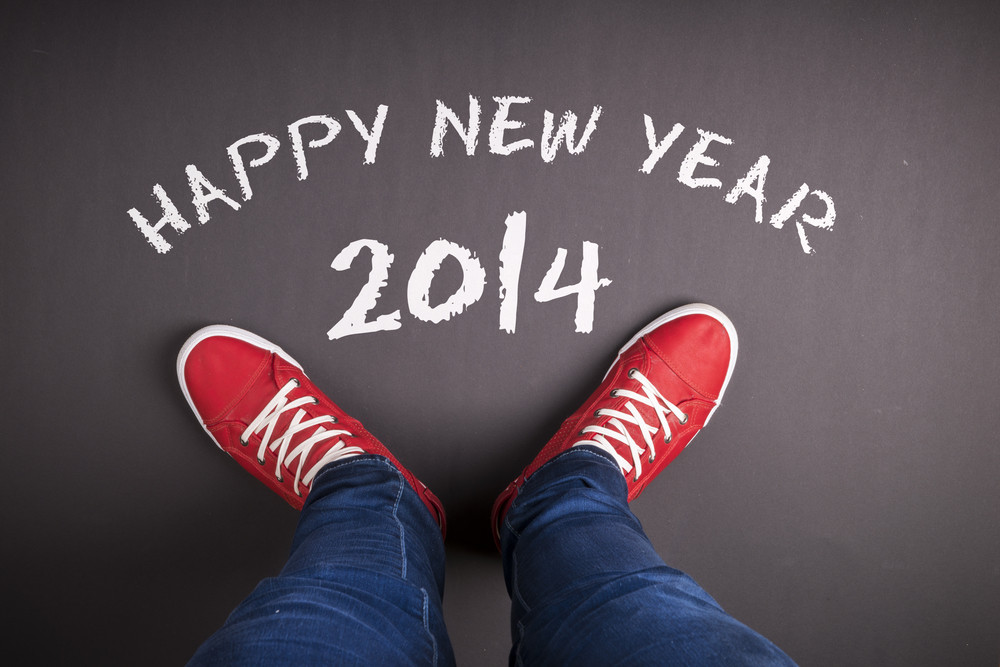 New year concept with red shoes and white chalk