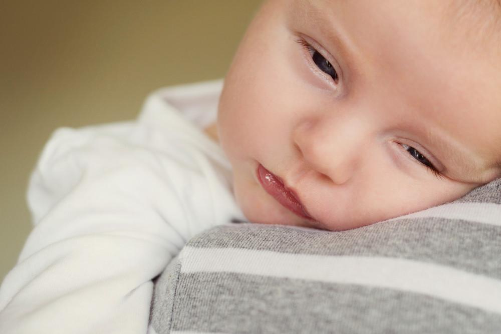 Newborn baby boy is tired and sleepy