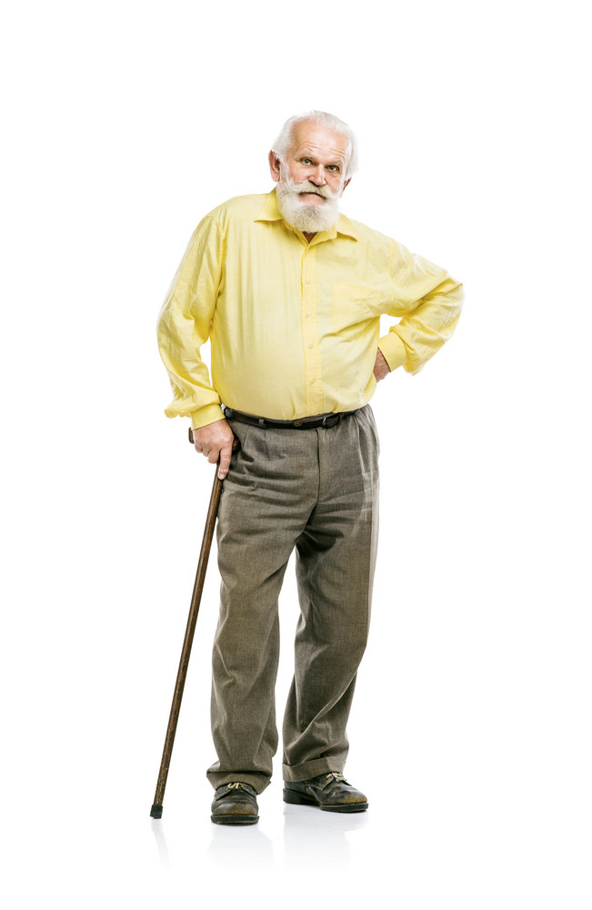 Old active bearded man walking with cane isolated on white background