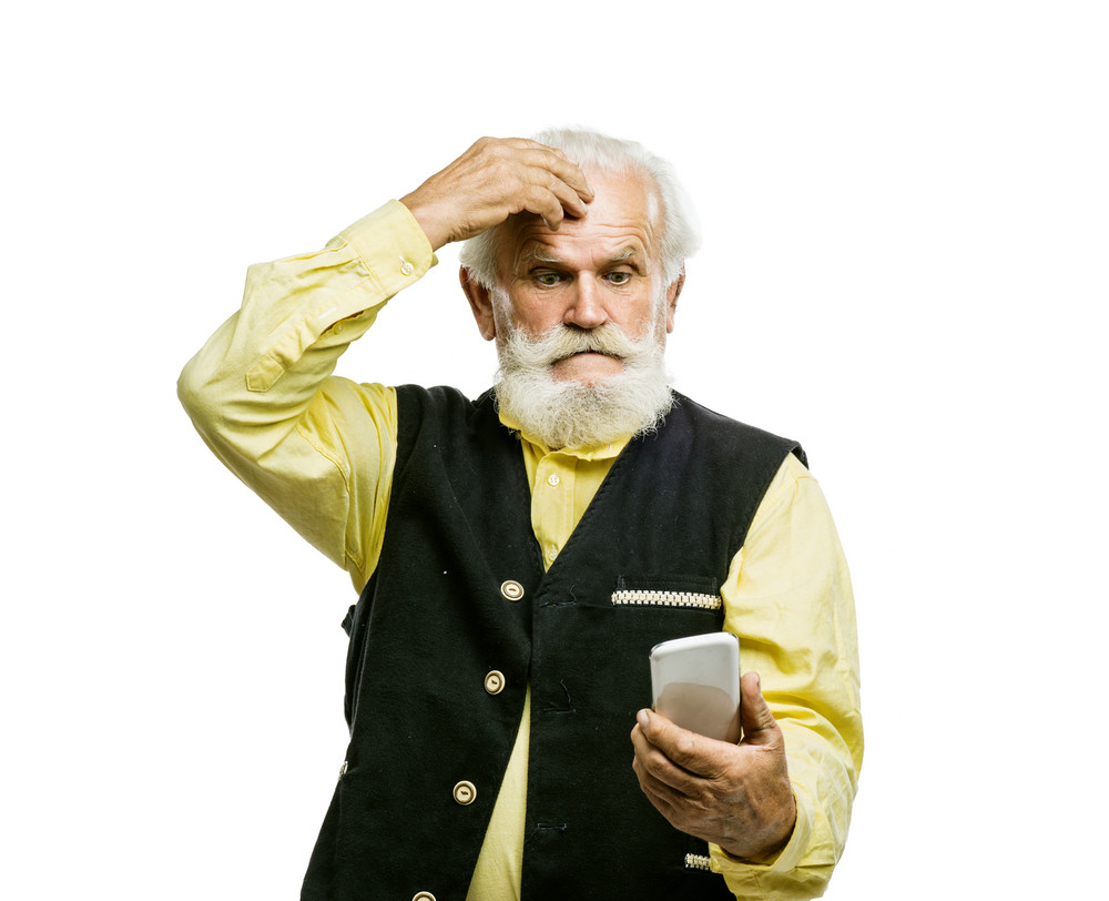 Old active bearded man with mobile phone isolated on white background
