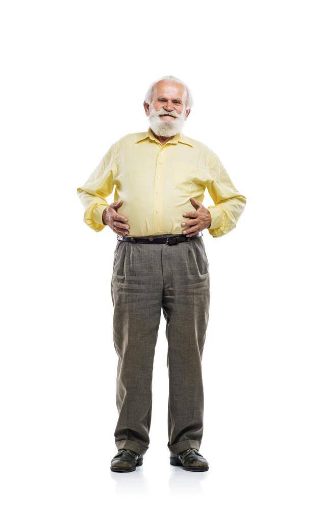 Old bearded man holding tummy isolated on white background