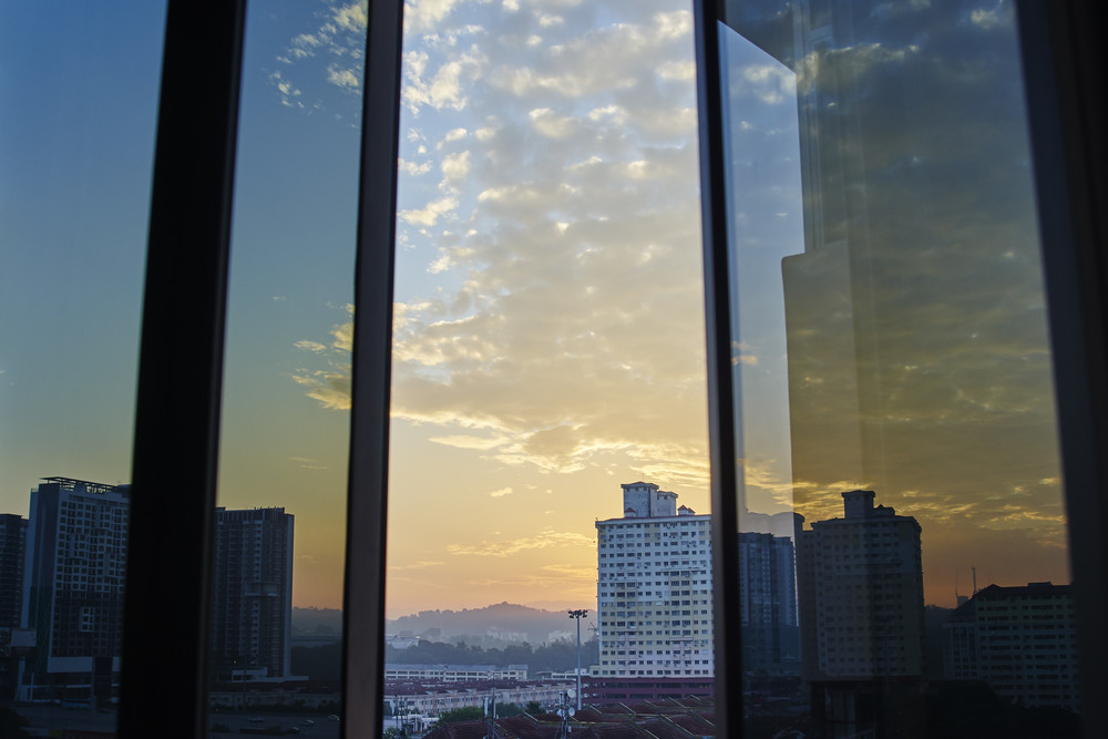 Open window with Romantic sunrise with beautiful clouds view