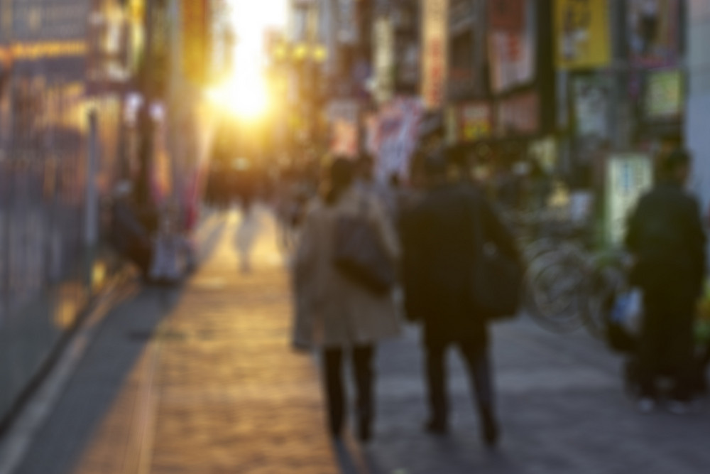 Osaka,Japan - 25 March,2015: Crowds walk below the signs of Dotonbori. With a history reaching back to 1612, the district is now one of Osaka's primary tourist destinations.