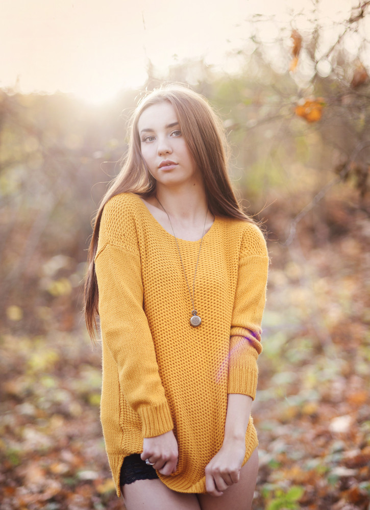 Outdoor portrait of beautiful girl in autumn forest