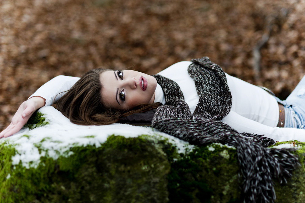 Outdoor portrait of beautiful woman in winter forest