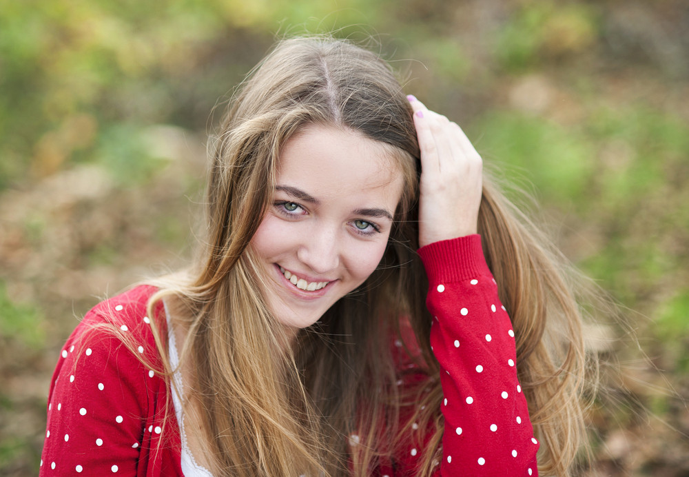 Outdoor portrait of beautiful young girl smiling