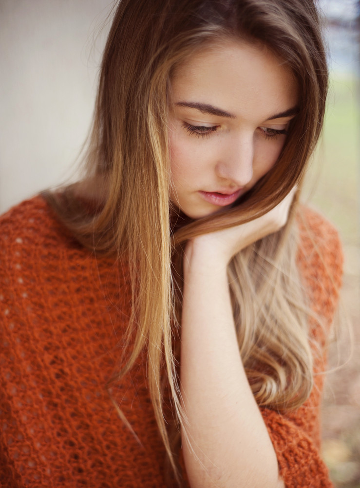 Outdoor Portrait Of Beautiful Young Sad Girl Thinking
